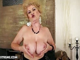 A really nasty older granny slut is spreading her pink pussy and posing in this nasty old porno...