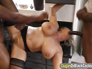 Black stallions hitting a busty MILF really hard