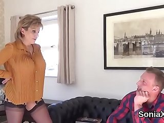 Adulterous british mature lady sonia shows her massive hooters