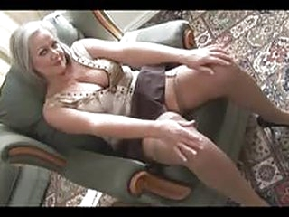free porn MILF Attractive busty granny in stockings stripping