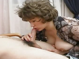 A mature woman is working really hard to get this young stud to fuck her